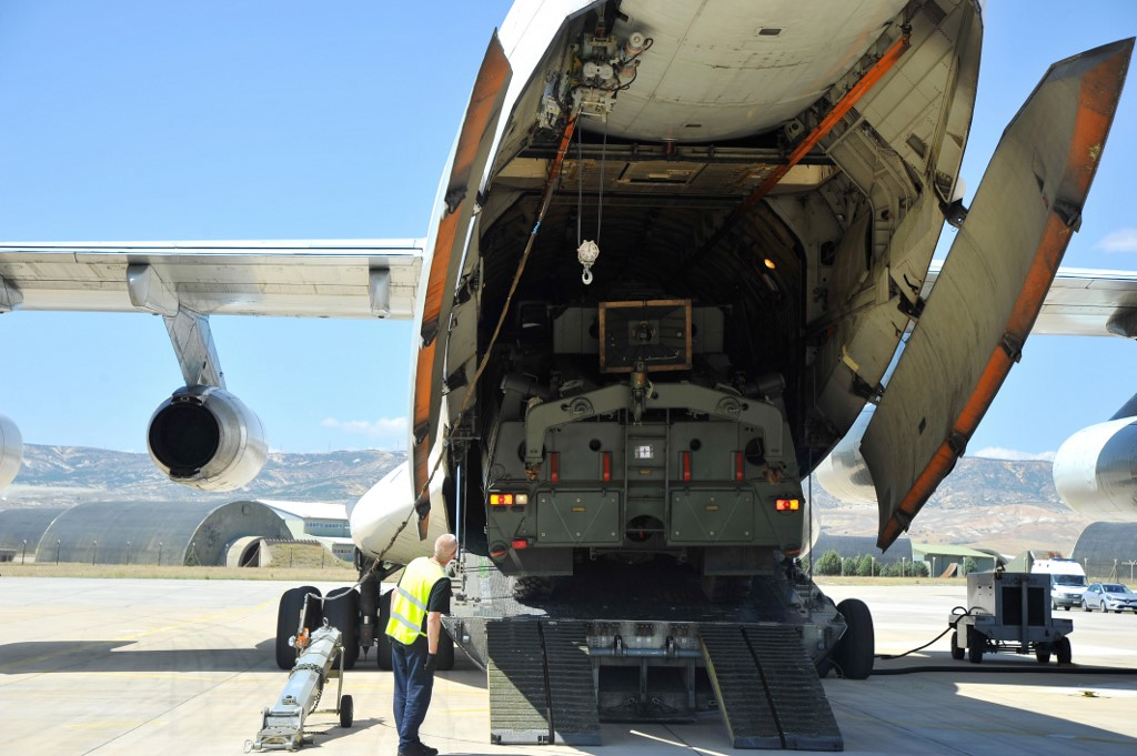 A Russian military cargo plane carrying the S-400 missile defence system is unloaded northwest of Ankara on 27 August (Handout/Turkish Defence Ministry/AFP)