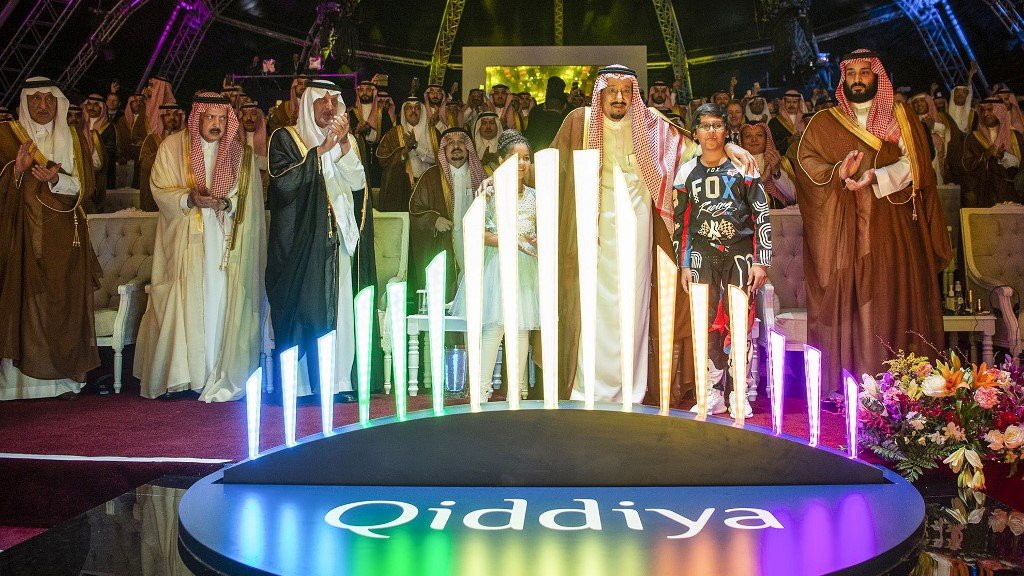 Saudi King Salman and Crown Prince Mohammed bin Salman launch a Vision 2030 'entertainment city' project southwest of Riyadh in 2018 (Bandar al-Jaloud/Saudi Royal Palace/AFP)