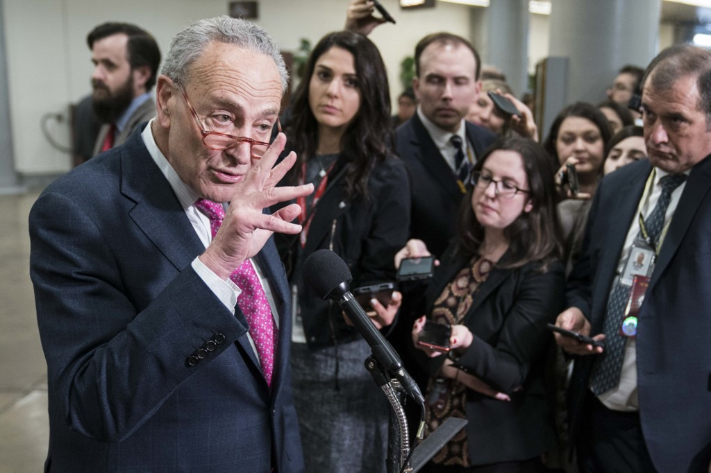Senate Minority Leader Chuck Schumer speaks to reporters in Washington on 29 January (AFP)