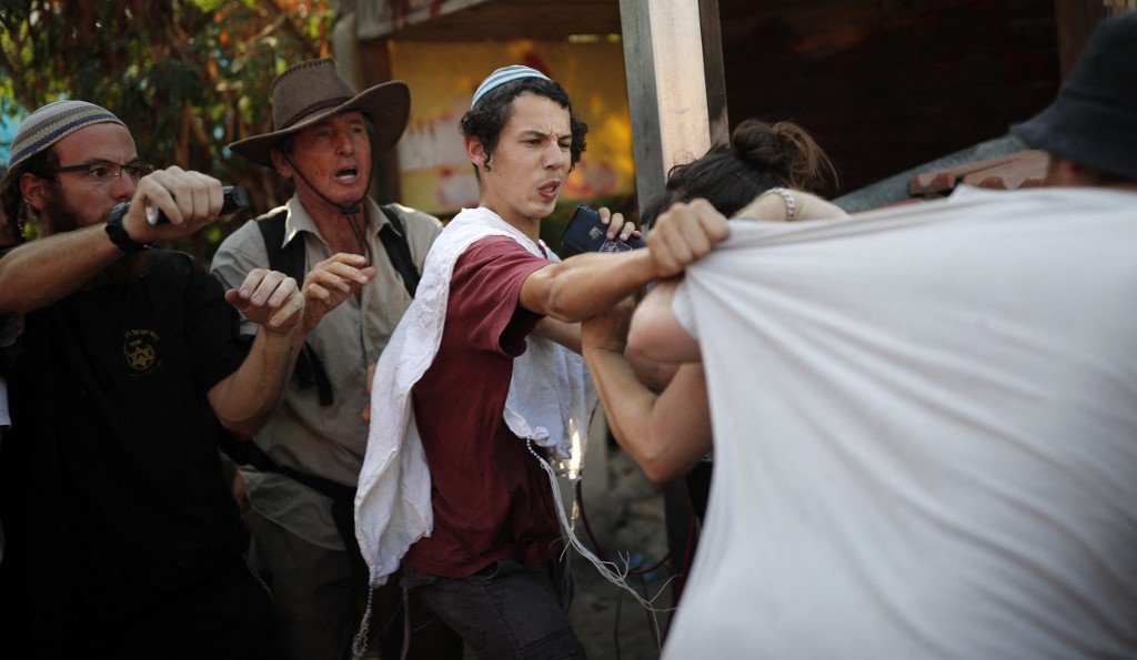 Jewish settlers clash with Peace Now activists in Sheikh Jarrah, Jerusalem, in 2017 (AFP)
