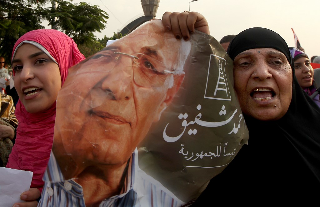 Supporters of then-presidential candidate Ahmed Shafiq demonstrate on the outskirts of Cairo in 2012 (AFP)