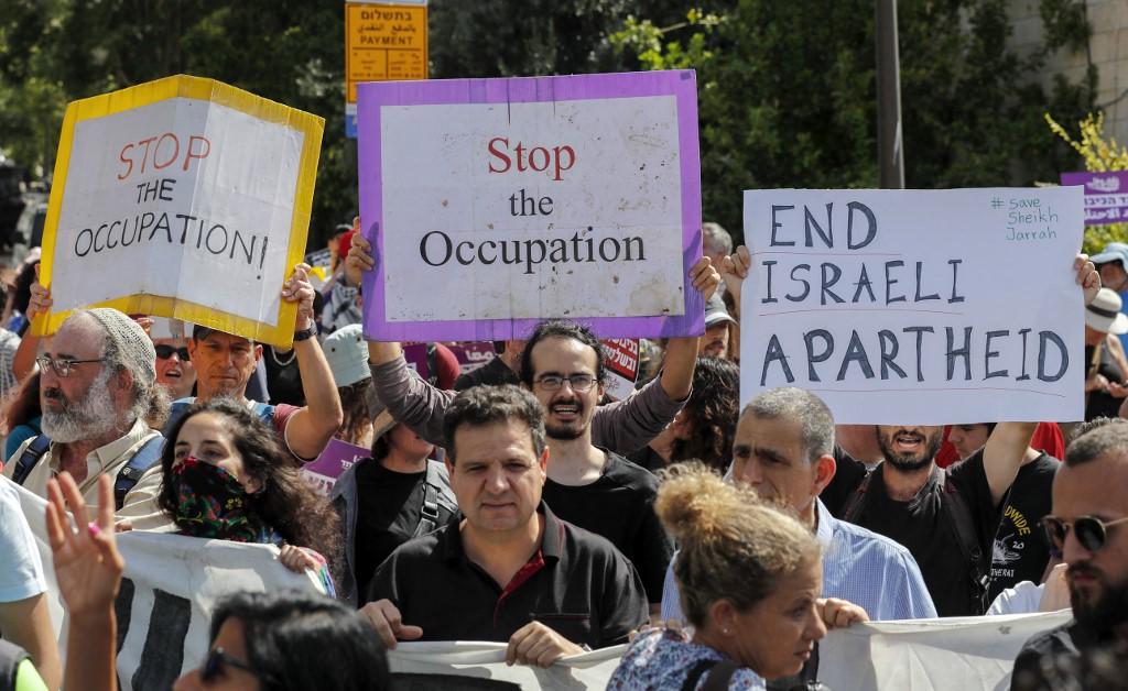 Activists protest against Israeli occupation near Sheikh Jarrah on 11 June 2021 (AFP)