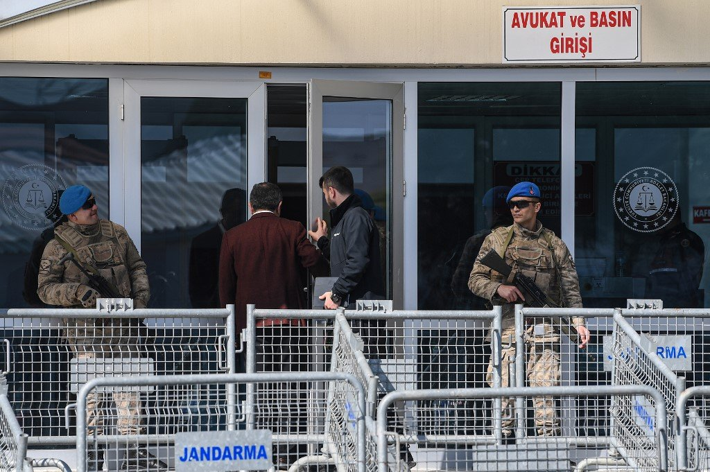 Turkish soldiers stand guard as two men enter the Silivri Prison and Courthouse complex in Silivri, near Istanbul on 18 February 2020 (AFP)