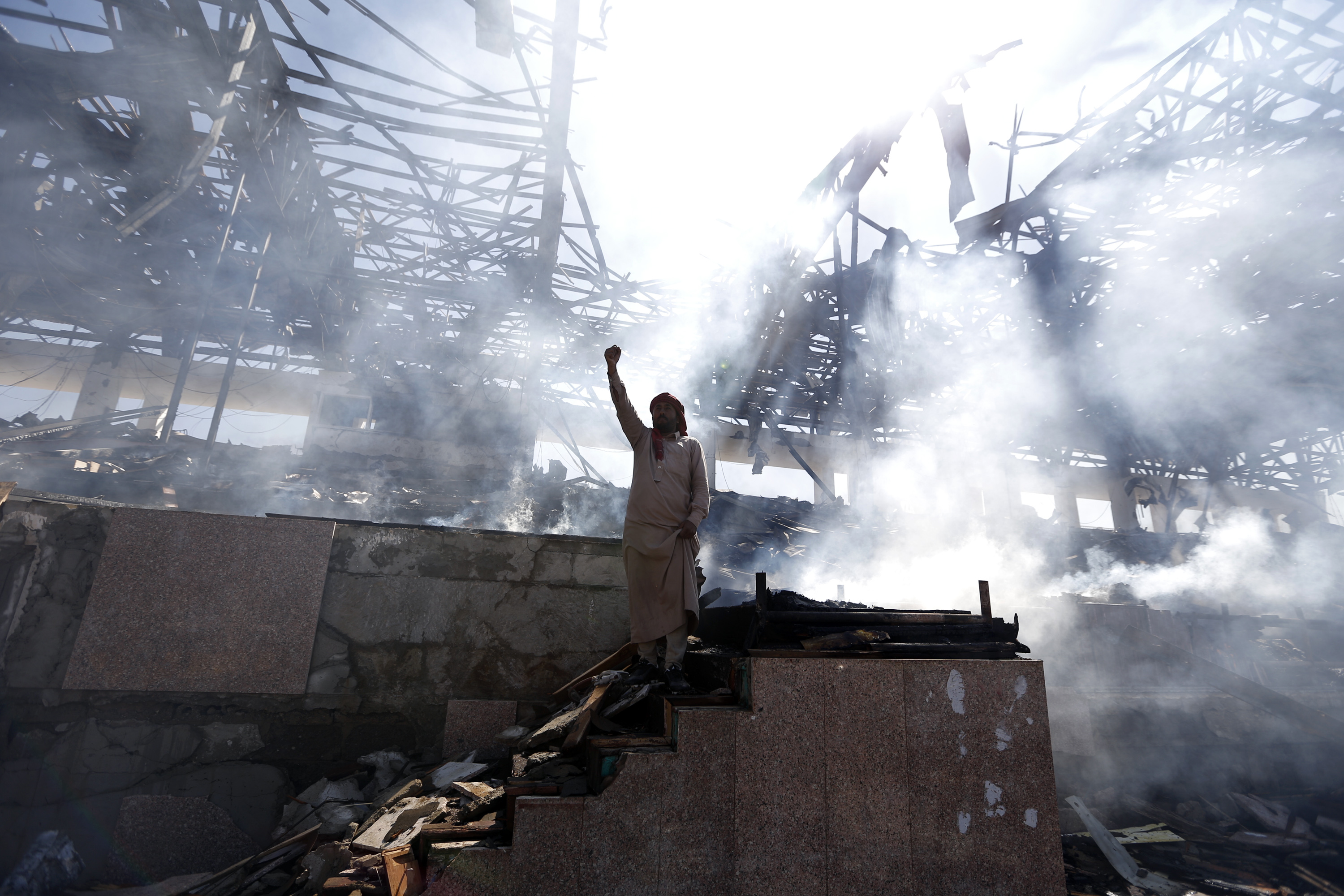 A Yemeni man gestures at the site of an air strike in the capital Sanaa, on November 5, 2017.