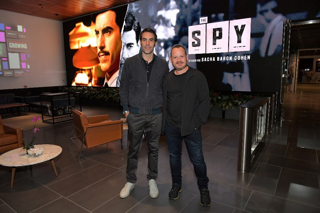 Sacha Baron Cohen and Gideon Raff attend a screening for The Spy in LA on 5 September (AFP)