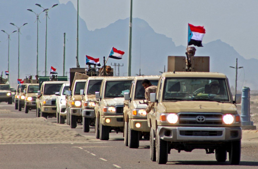 A convoy of forces dominated by members of Yemen's Southern Transitional Council heads from Aden to Abyan province on 26 November (AFP)