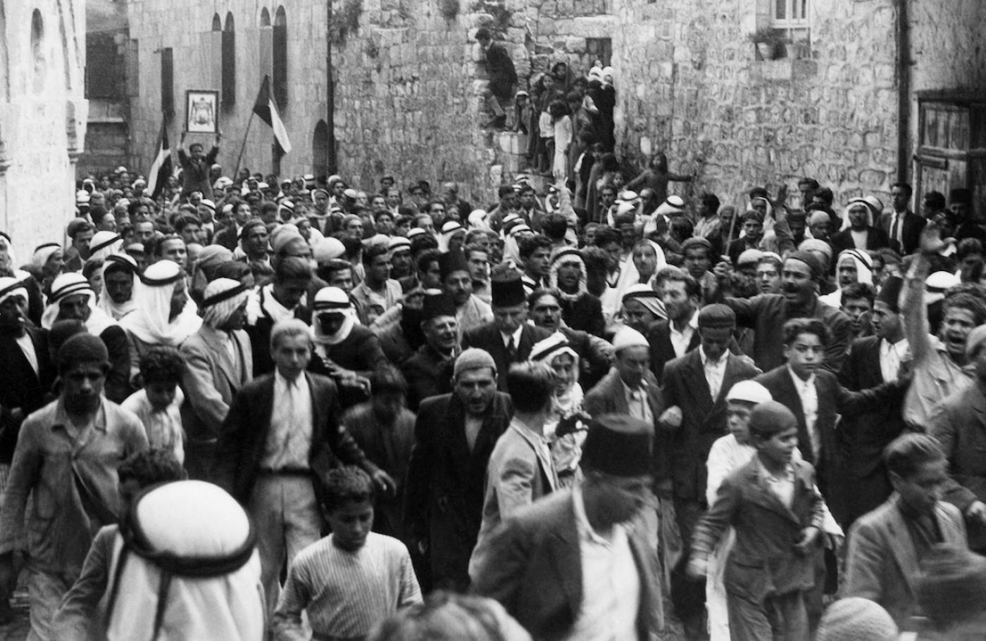 A picture dated before 1937 during the British Mandate in Palestine shows Arabs demonstrating in the Old City of Jerusalem against the Jewish immigration to Palestine (AFP)