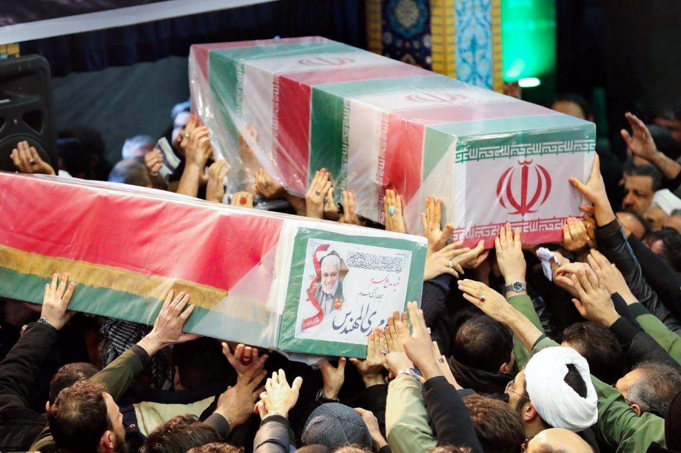 The caskets of Soleimani and Iraqi paramilitary chief Abu Mahdi al-Muhandis were carried through to the front at Tehran University (AFP)