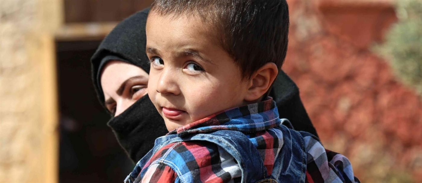 Bringing up baby in a Syrian jail: I covered his ears to