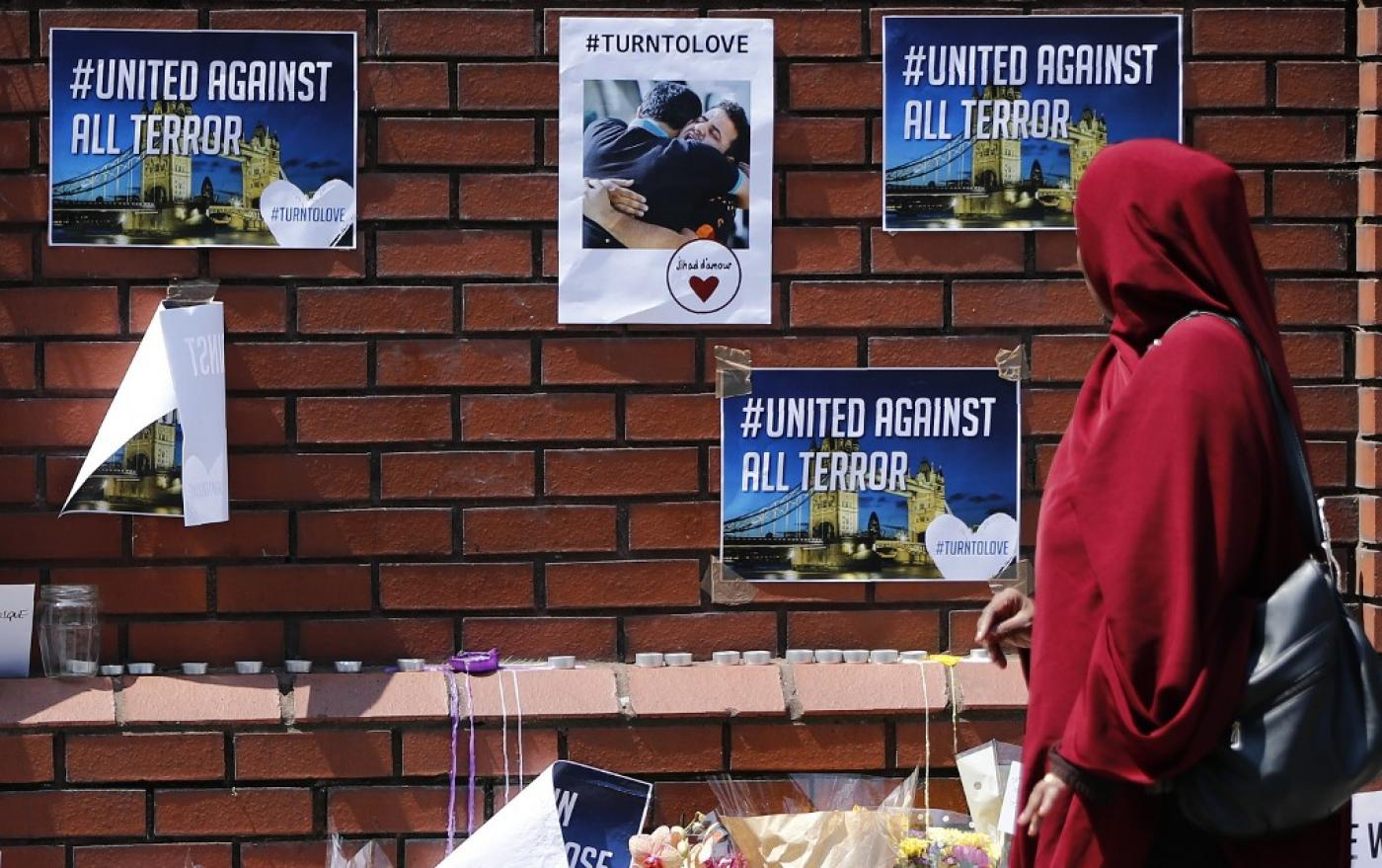 Posters on the wall outside Finsbury Park Mosque following a van-ramming attack at another mosque nearby (AFP)