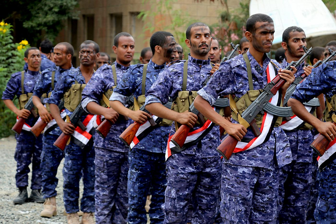 Yemeni fighters from the Popular Resistance take part in a graduation ceremony in the city of Taiz, on 5 August 2019 (AFP)