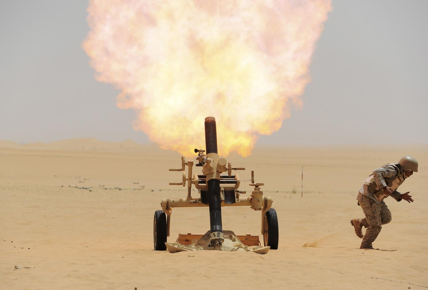 A Saudi soldier fires a mortar towards Houthi movement position, at the Saudi border with Yemen (Reuters)