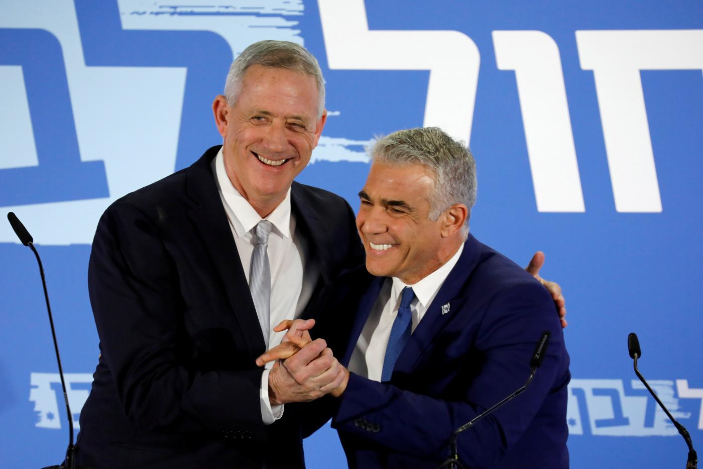 Benny Gantz, head of Resilience party and Yair Lapid, head of Yesh Atid, hold a news conference to announce the formation of their joint party (Reuters)