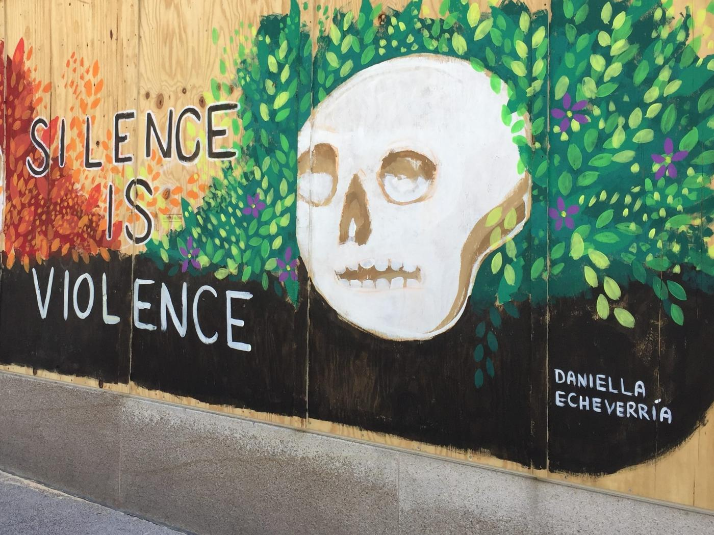 Artwork carrying messages of peace as seen in this mural in Madison, Wisconsin, by Daniella Echeverria on 7 June (Reuters)