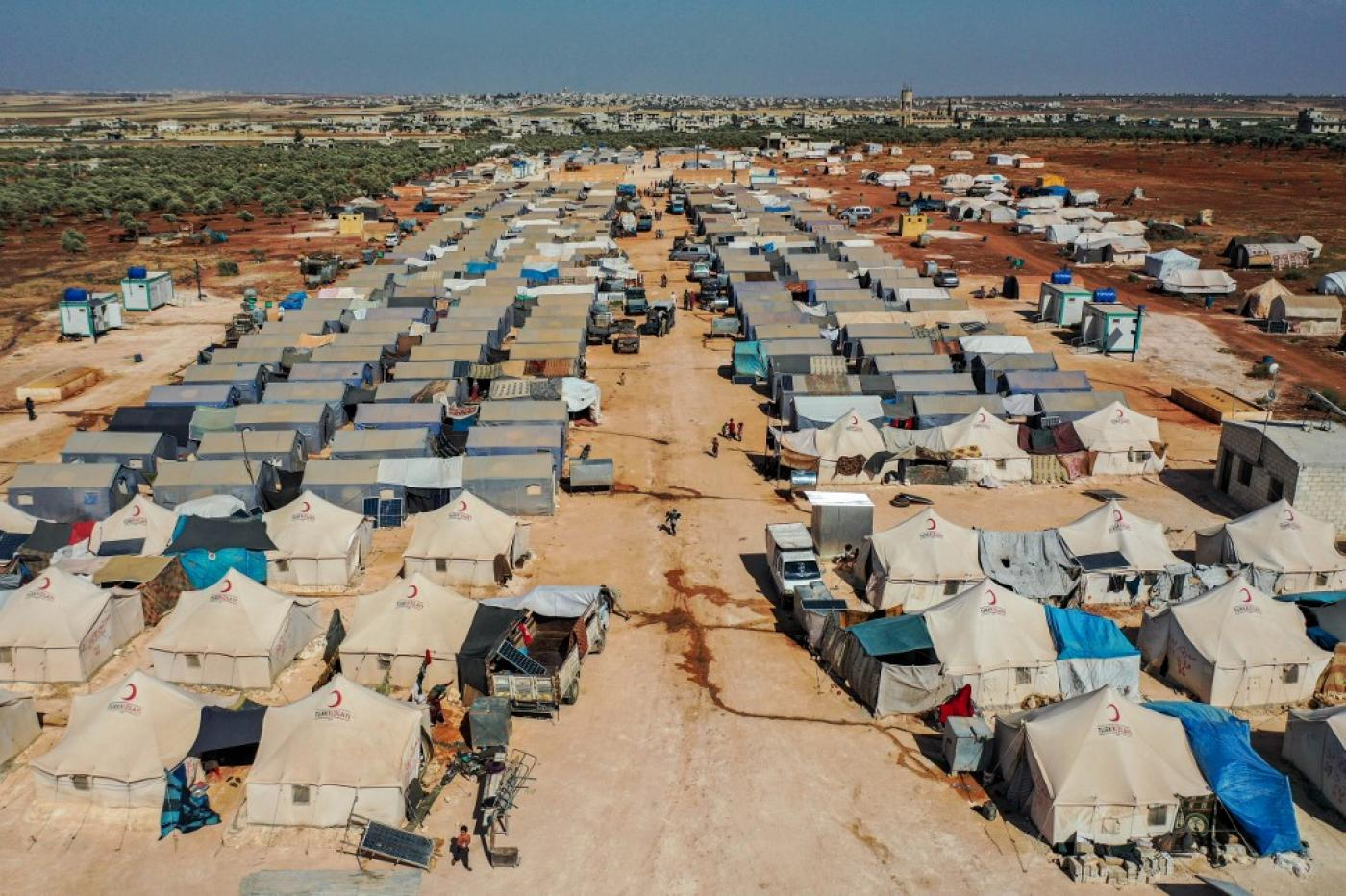 A view over Azraq camp for displaced Syrians near the town of Maaret Misrin in Syria's northwestern Idlib province on 9 July (AFP/File photo)