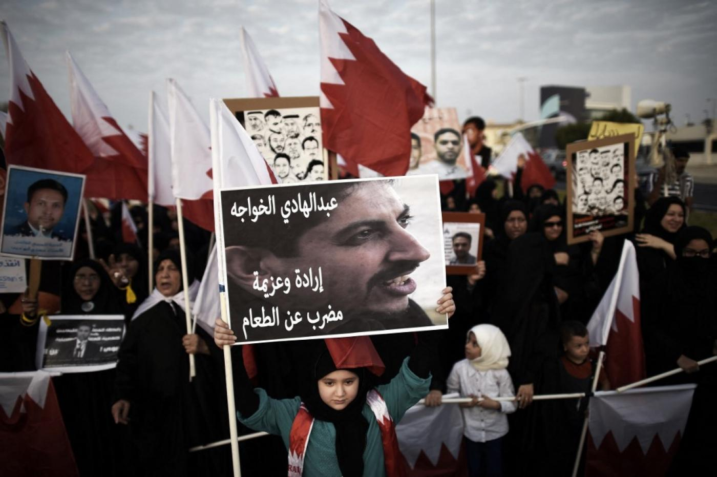 "A placard reads ""Abdulhadi al-Khawaja, will and determination, hunger strike"" during an anti-government protest on 5 September 2014 (AFP/File photo)"