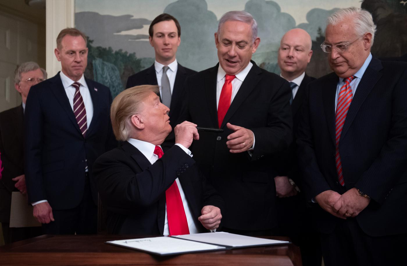 This image of Donald Trump handing Benjamin Netanyahu a pen was used in J Street's promotion