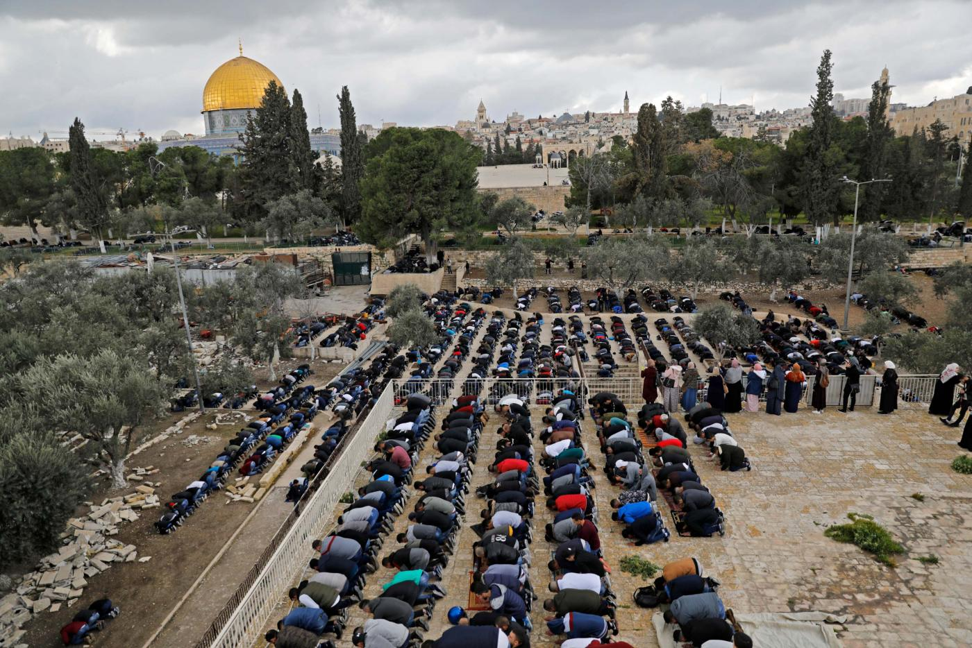 Palestinians Muslim worshippers pray in the Al-Aqsa Mosque compound in the Old City of Jerusalem, on 22 February 2019 (AFP)