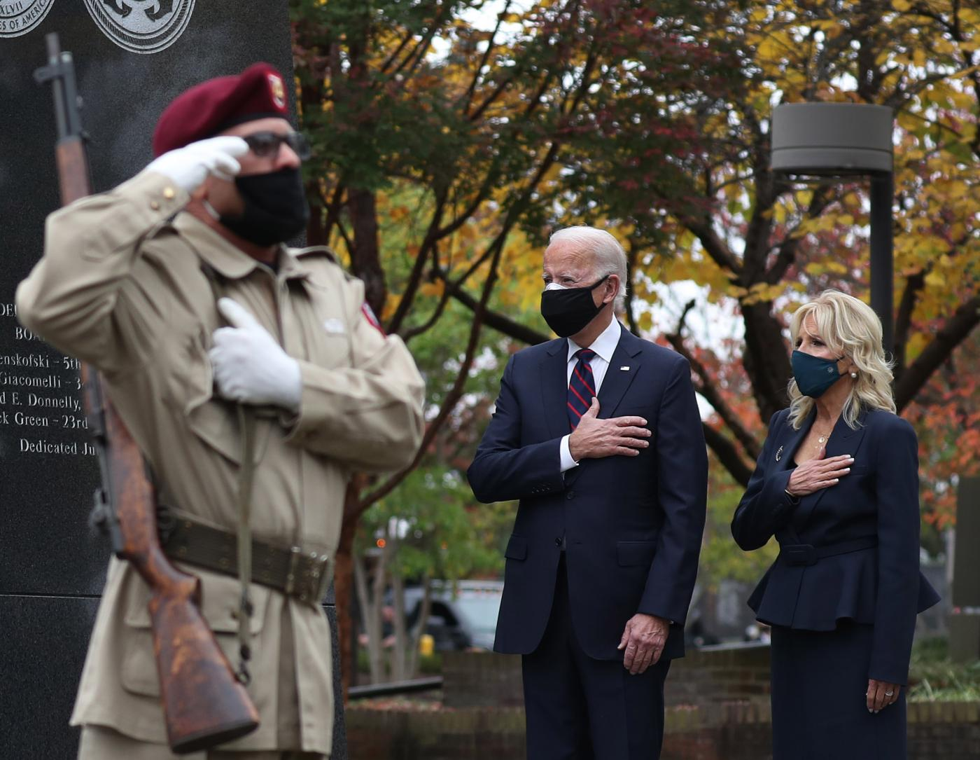 Joe Biden and his wife Jill pay respects during a Veterans Day stop at the Korean War Memorial Park in Philadelphia, Pennsylvania on 11 November.