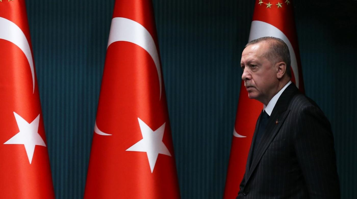 President Recep Tayyip Erdogan arrives for a news conference in Ankara