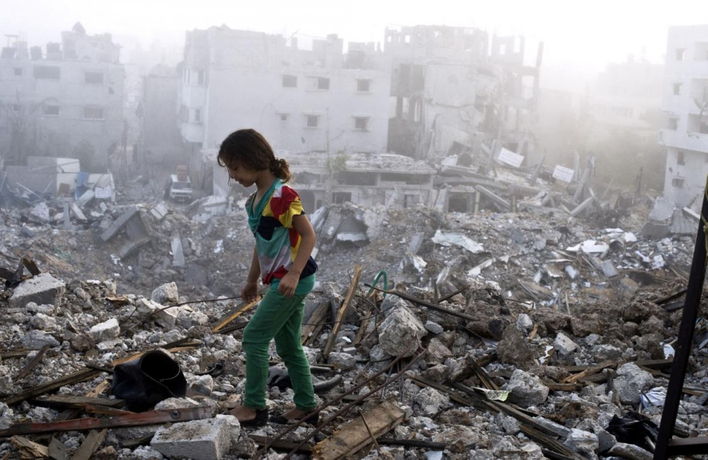 This image has an empty alt attribute; its file name is gaza%20rubble%202014%20afp.jpg