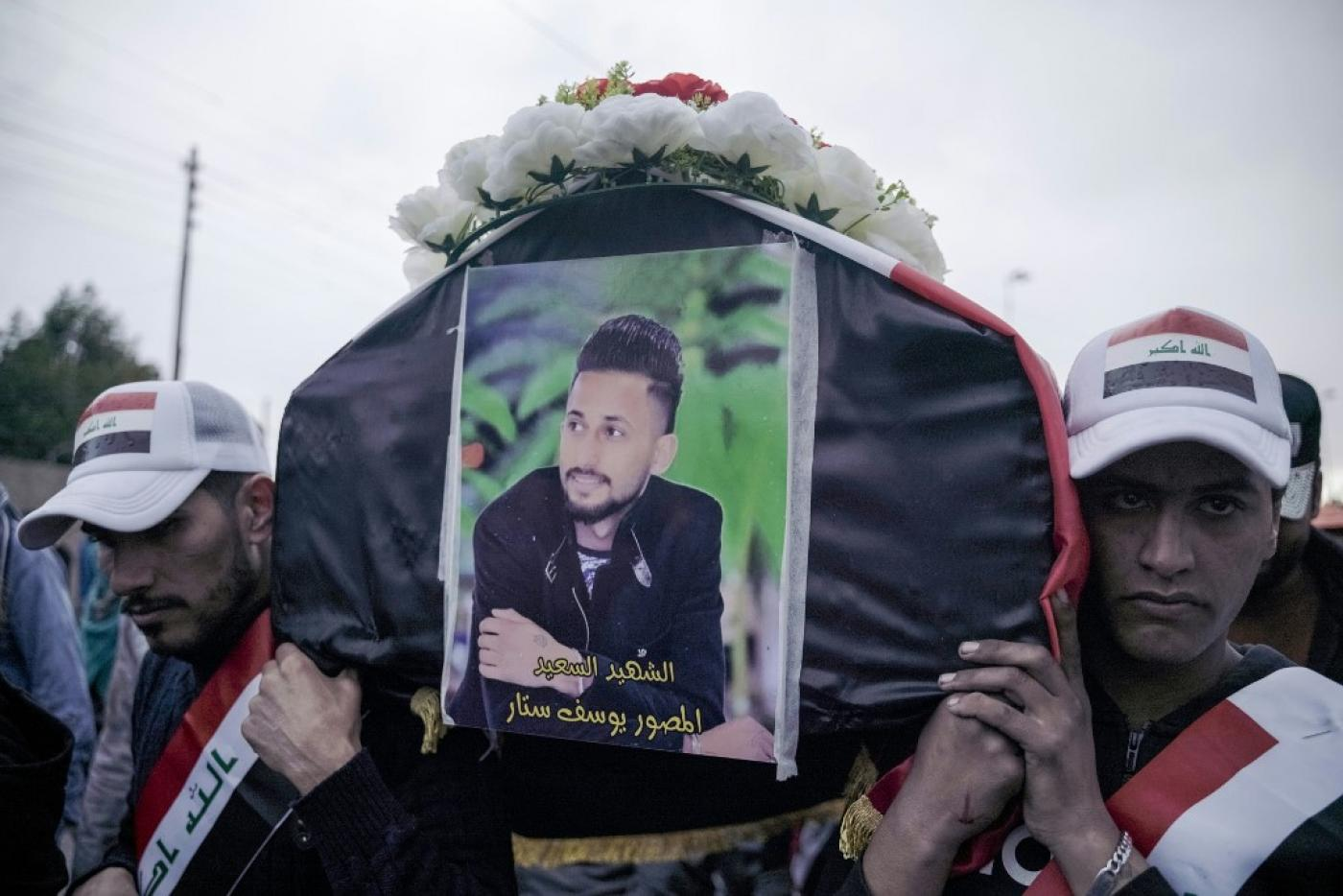Mourners carry the coffin of Yussef Sattar, a journalist reportedly killed while covering anti-government protests in Iraq in January 2020.