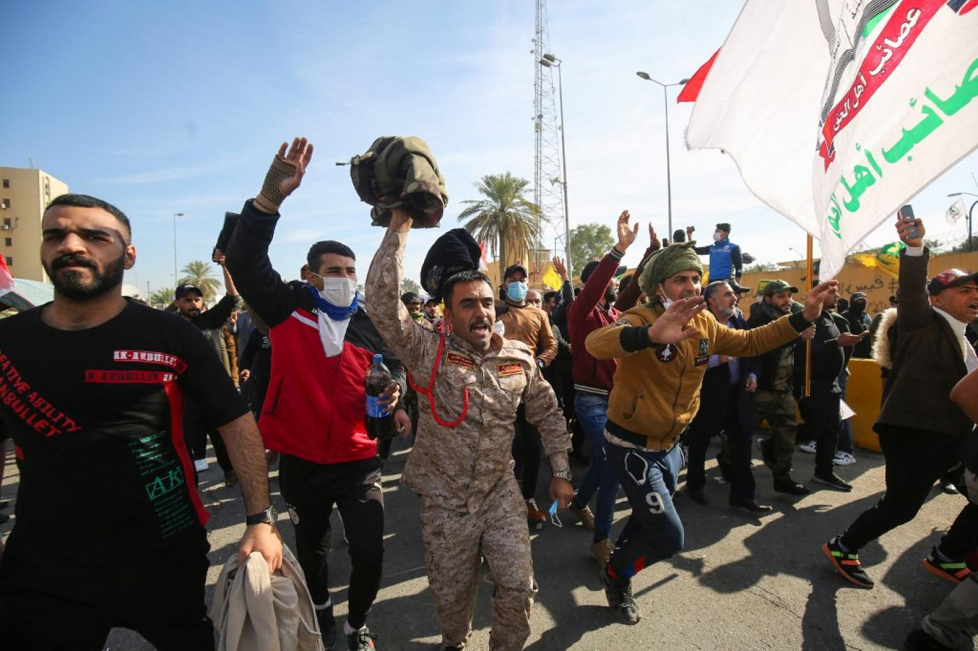 The Iran-backed Hashd al-Shaabi protest outside the US embassy in Baghdad on 1 January 2020