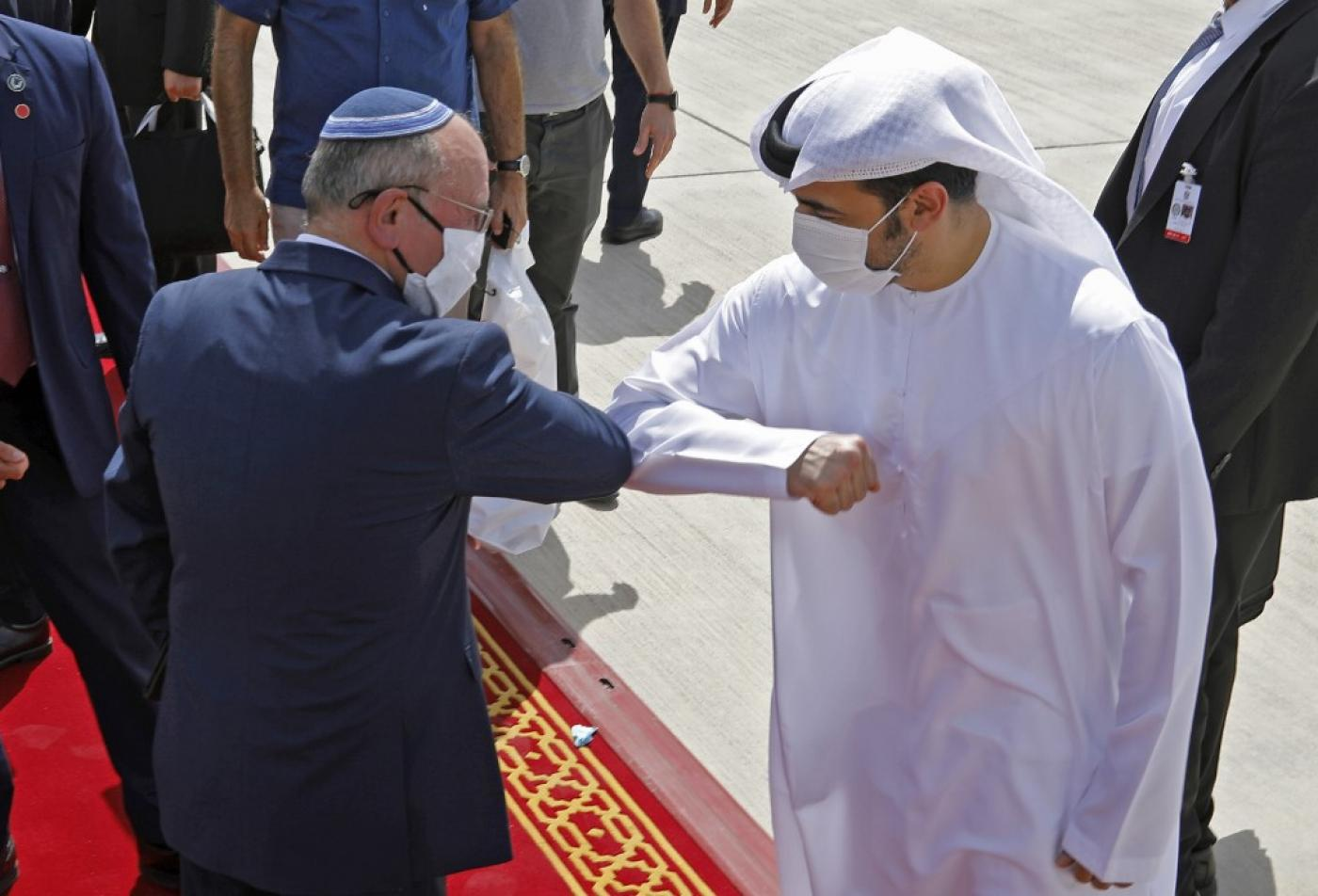 Israeli National Security Advisor Meir Ben-Shabbat elbow bumps with an Emirati official on 1 September.