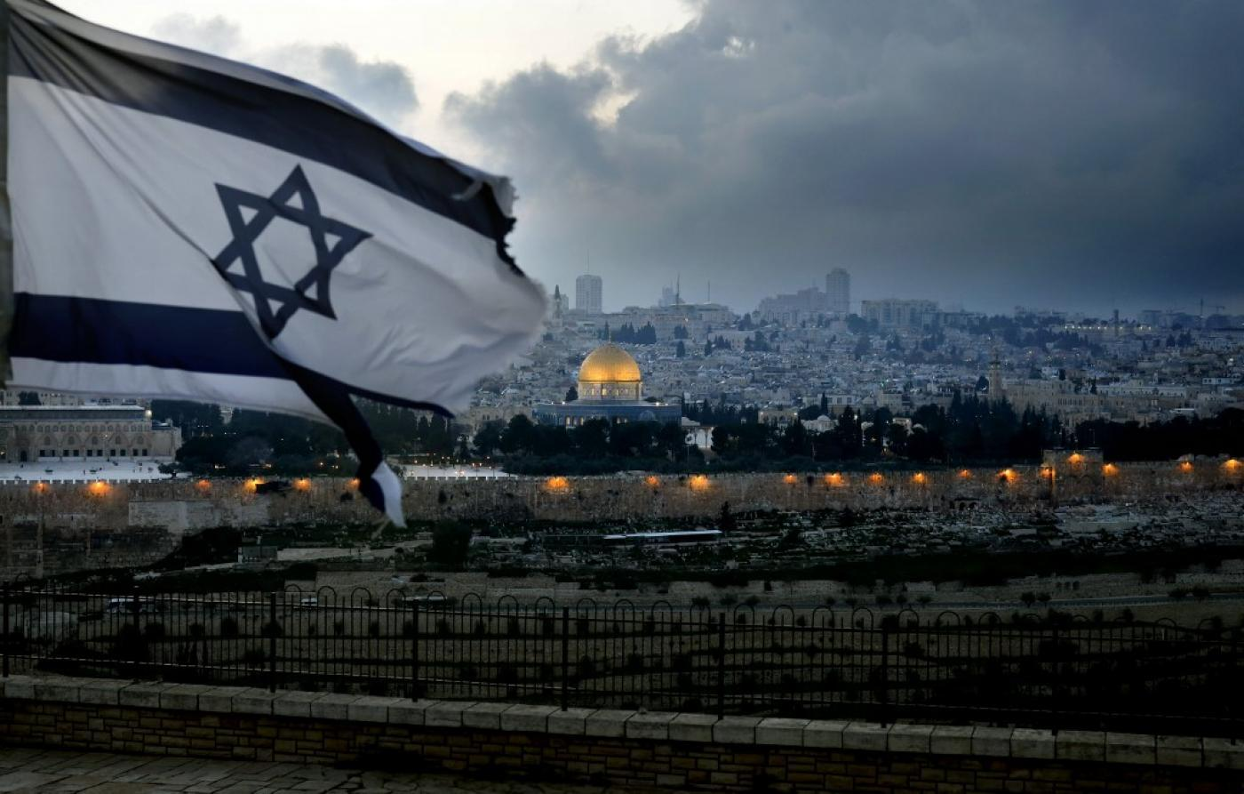 Israeli flag with Old City of Jerusalem in background