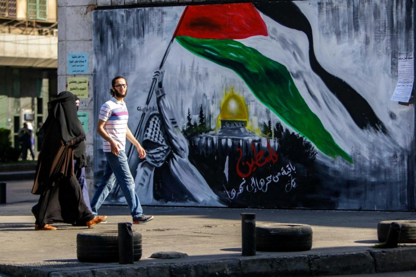 """A mural reads """"Palestine will remain, from the river to the sea"""""""