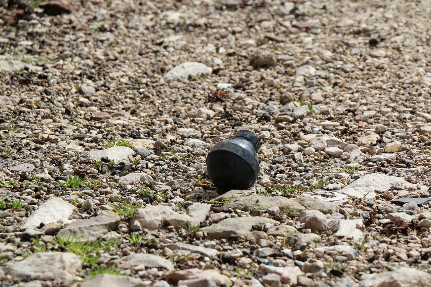 Remnants of a sound bombs set off by the soldiers in front of Abu Srour's home (MEE/Akram al-Waara)