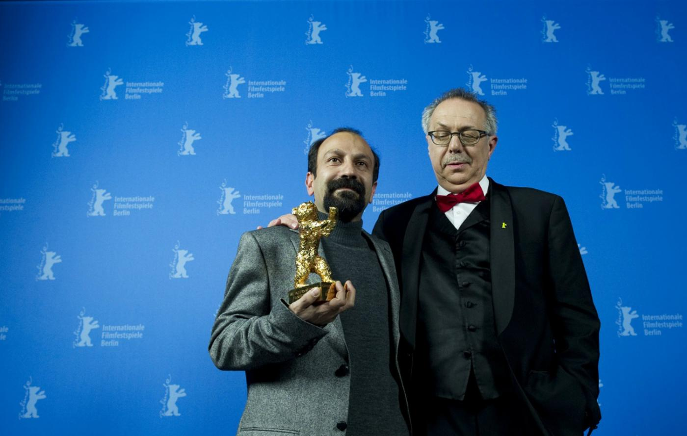 Asghar Farhadi, left, in 2011 with the Golden Bear he won in 2011 for A Separation: to his right is festival chief Dieter Kosslick (AFP)