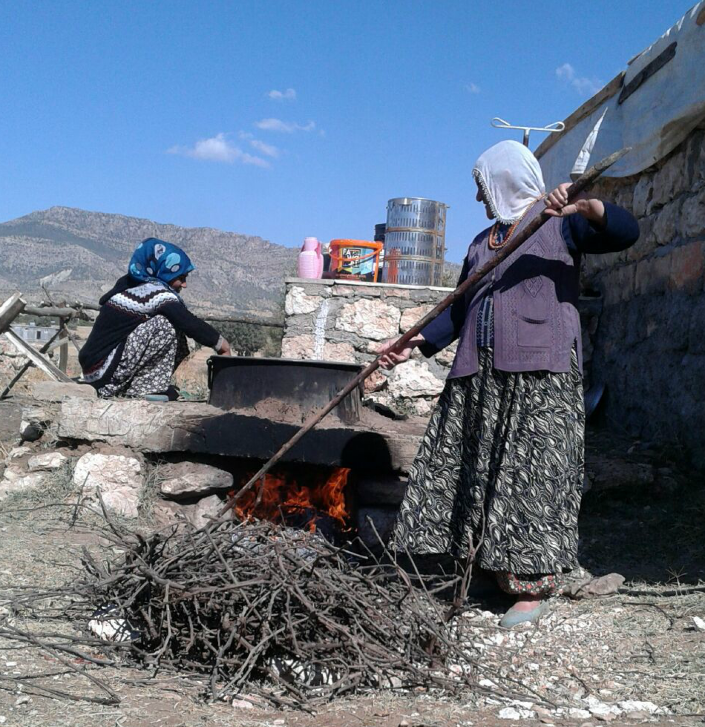 ​  Kurdish women hired by Hevsel Bahcesi cooking what eventually becomes fruit leathers with walnuts (Courtesy of Sehadet Citil)  ​