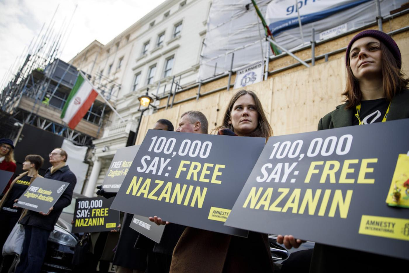 Campaigners hold posters as Richard Ratcliffe, husband of jailed  British-Iranian woman Nazanin Zaghari-Ratcliffe, delivers a petition and a  letter addressed ...