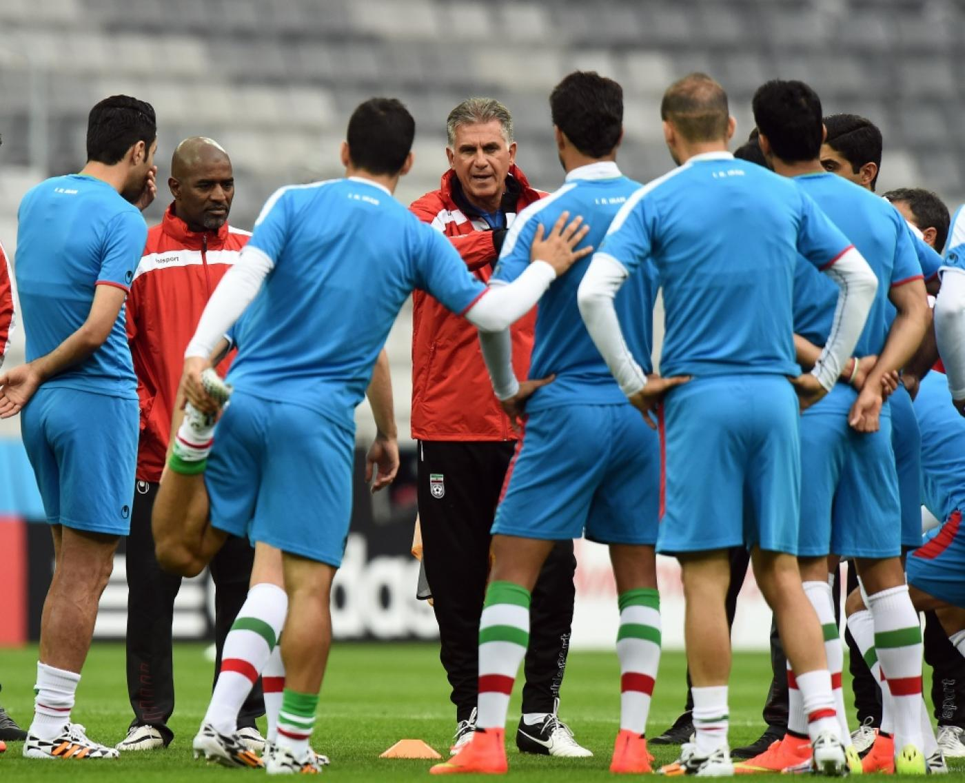 8392976da Iran s coach Carlos Queiroz (back C) speaks to his teams during a training  session in Curitiba on June 15