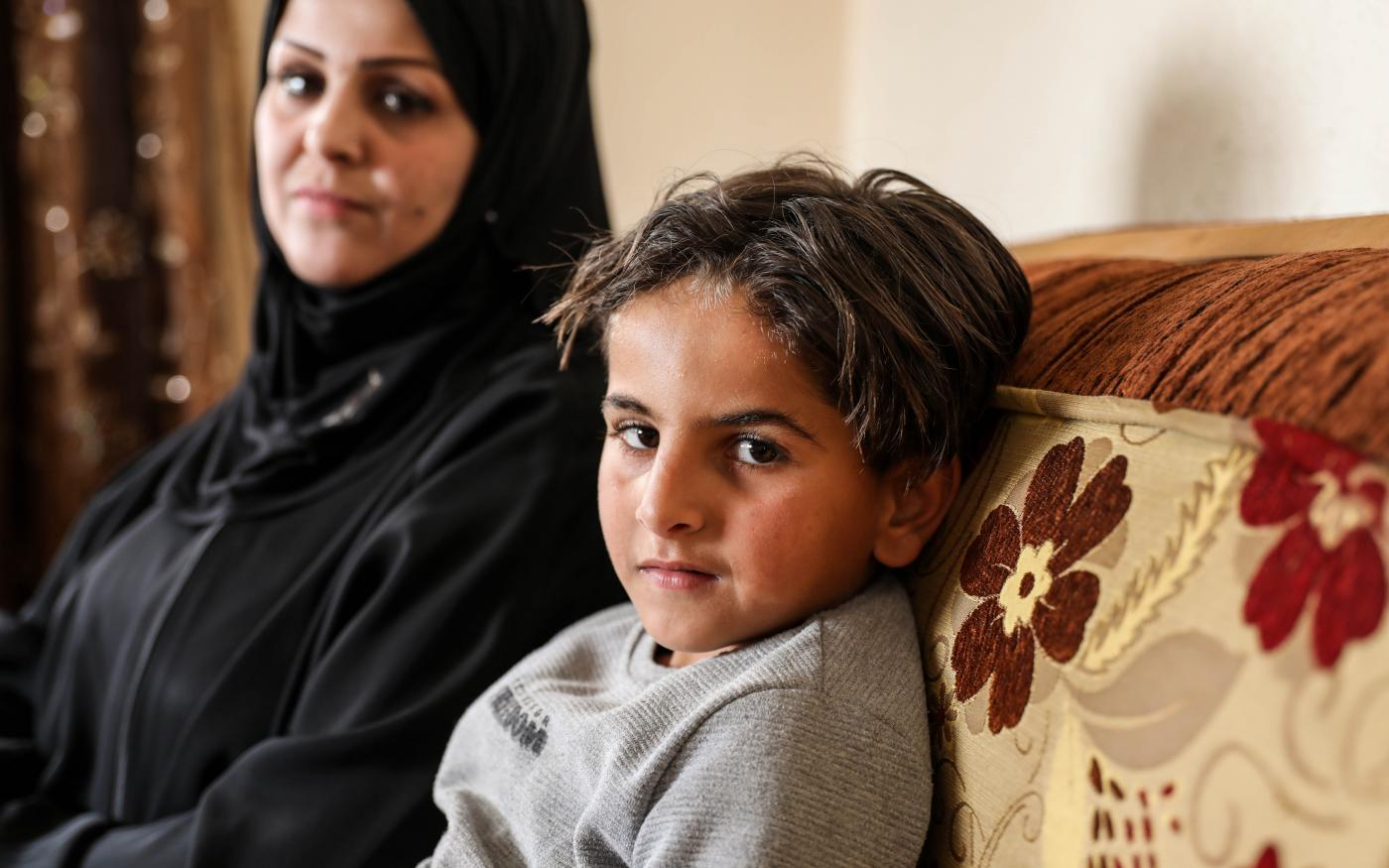 Fearing her son Ameer's anxiety might worsen, Gharqoud now teaches him at home. March 2021 (Mohammed A. Alhajjar)
