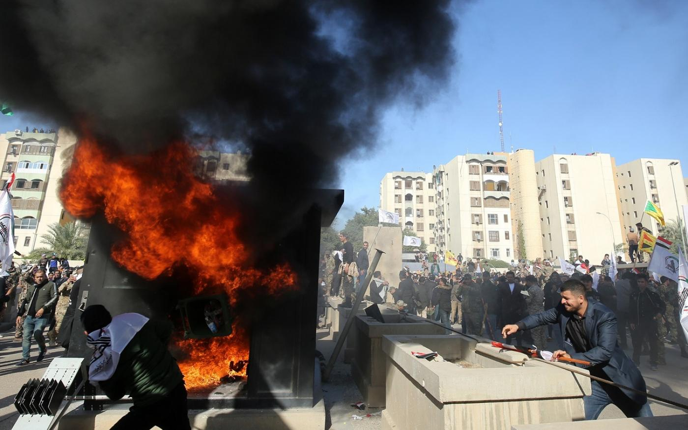 Iraqi protesters set ablaze a sentry box in front US embassy Baghdad December 2019 afp
