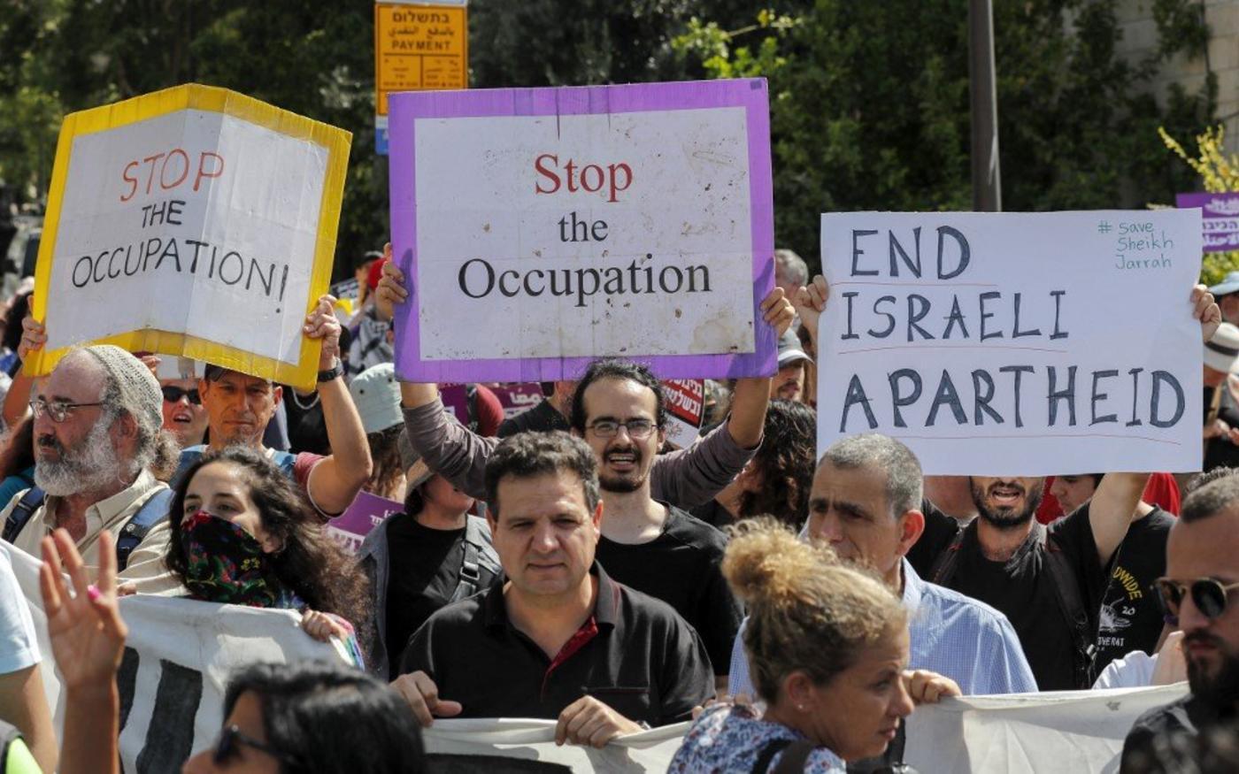 Des activistes manifestent contre l'occupation israélienne près de Sheikh Jarrah, le 11juin2021 (AFP)