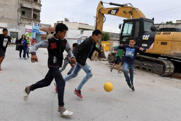 Children play in the streets of Ettadhamen, an impoverished area of Greater Tunis (AFP)