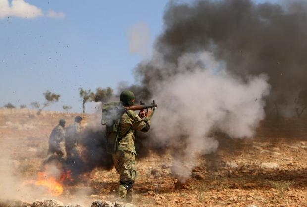 A Syrian rebel fighter takes part in combat training in the Idlib countryside
