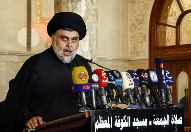 Iraqi Shia leader Muqtada al-Sadr delivers a speech at the grand mosque of Kufa on 21 September (AFP)