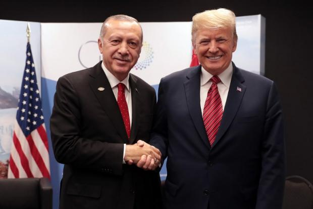 Turkish President Recep Tayyip Erdogan poses with US President Donald Trump during the G20 summit in Buenos Aires on 1 December (Murat Cetinmuhurdar/Turkish Presidential Press Service/AFP)