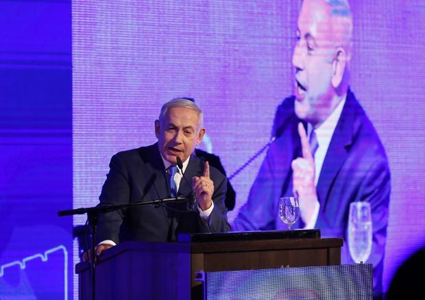 Israeli Prime Minister Benjamin Netanyahu delivers a speech at the start of Hanukkah on 2 December (AFP)
