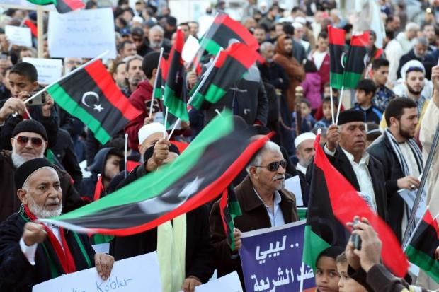 Libyans protest against a UN-sponsored agreement on forming a national unity government on 18 December 2015 in the capital Tripoli (AFP)