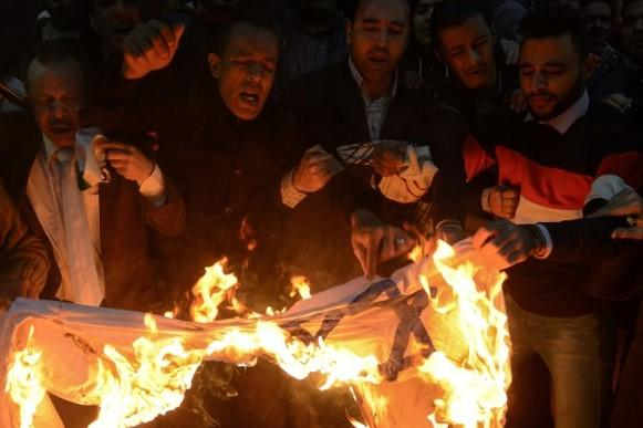 Egyptian protesters burn an Israeli flag during a demonstration against the US president's recognition of Jerusalem as Israel's capital, on 7 December, 2017 (AFP)