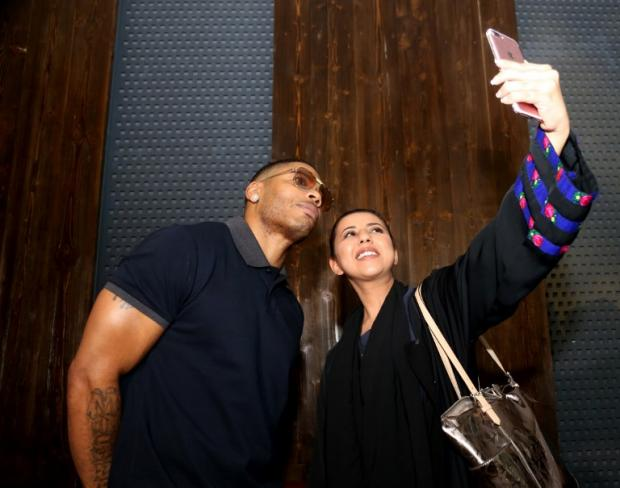 US rapper Nelly poses for a picture with a fan ahead of a male-only concert at King Abdullah Economic City on 14 December 2017 (AFP)