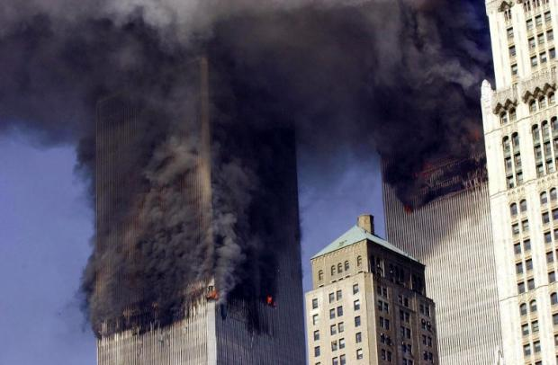The twin towers of the World Trade Center burn on 11 September 2001 (AFP)
