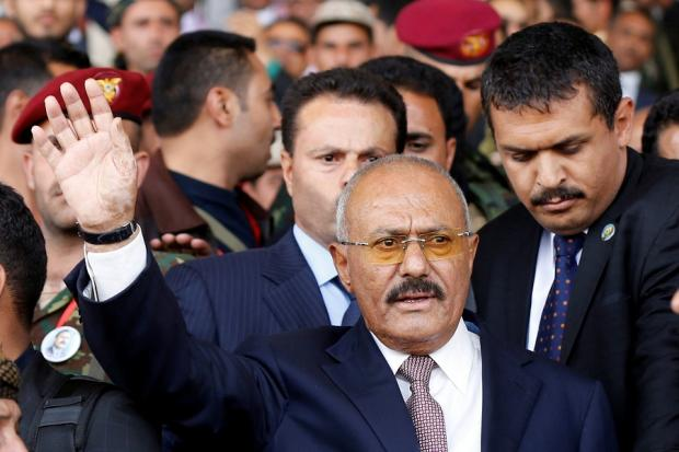 Former President Saleh gestures to supporters as he arrives to a rally held to mark the 35th anniversary of the establishment of GPC party in Sanaa August 24, 2017 (Reuters)