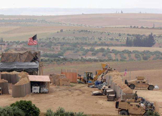 Turkish and US troops begin joint patrols in Syria's Manbij