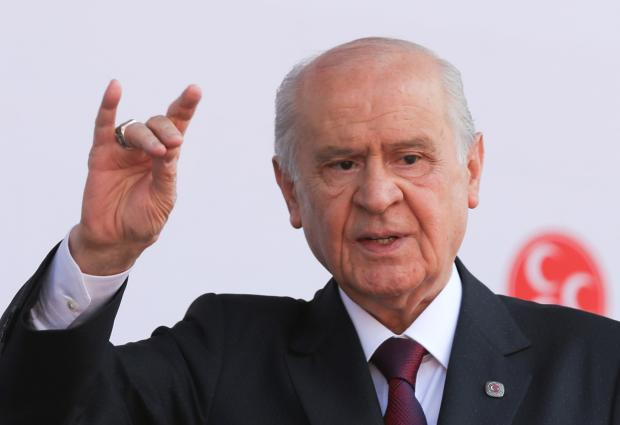 Devlet Bahceli makes the Grey Wolf sign.